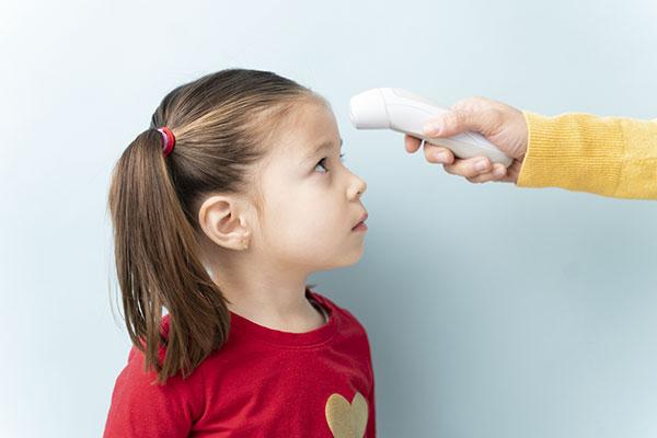 Parent checking girl's temperature